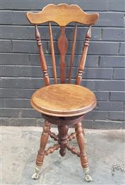 Sale 9048 - Lot 1077 - Late 19th Century American Piano Stool, with high spindle back & swivel seat, on turned legs with glass ball & claw feet (H:92 x W:4...