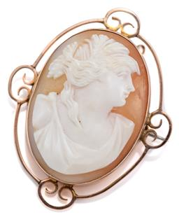 Sale 9074 - Lot 367 - AN ANTIQUE 9CT GOLD CAMEO BROOCH; carved shell cameo featuring a classical portrait set in a plain surround with scroll highlights,...