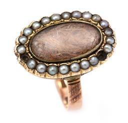 Sale 9120H - Lot 300 - A Georgian 9ct gold mourning ring set with hair lock compartment surrounded by seed pearls (missing 2), ring size L, total wt. 5.48g