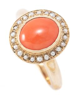 Sale 9246J - Lot 355 - A 9CT GOLD CORAL AND PEARL CLUSTER RING; centring an oval cabochon coral to surround of 22 seed pearls, size N1/2, top 14 x 12.5 mm,...