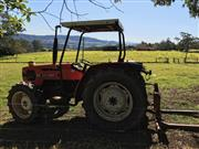 Sale 8380A - Lot 2D - A Same Explorer II tractor, showing 19,261 hours, build date circa 1992, includes hydraulic lift tines.