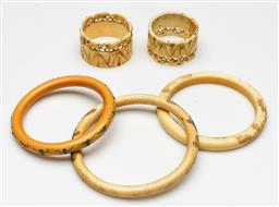 Sale 9209 - Lot 36 - A collection of bone and ivory bangles and napkin rings