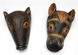 Sale 9253 - Lot 158 - A handpainted cultural wood carving of a horse head (L:25cm) together with an other example