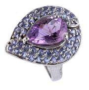 Sale 8946 - Lot 345 - A STERLING SILVER AMETHYST COCKTAIL RING; drop shape mount centring a chequerboard pear cut amethyst to surround of round cut amethy...