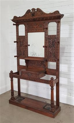 Sale 9215 - Lot 1002 - Late Victorian Profusely Carved Oak Hallstand, with floral motifs & lion heads, with central mirror, above a shelf & drawer, raised...