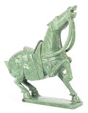 Sale 8269A - Lot 15 - Mottled green hardstone hand carved Tang style horse, H 35.5cm
