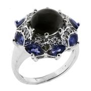 Sale 8050B - Lot 48 - A STERLING SILVER GEM SET CLUSTER RING;  centring a cat's eye quartz surrounded by marquis cut tanzanites and single cut diamonds. S..