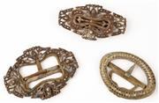 Sale 9048A - Lot 78 - Three belle epoque brass and copper belt buckles, inlaid with diamantes, largest Length 10cm