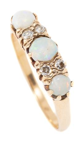 Sale 9160 - Lot 352 - A VINTAGE 14CT GOLD OPAL AND DIAMOND RING; set across the top with 3 cabochon solid opals (wear) between 4 round brilliant cut diamo...