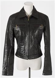 Sale 8541A - Lot 54 - A Transmission black leather zip front biker jacket, size medium or 8-10