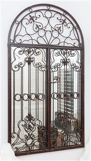 Sale 8902H - Lot 84 - A wrought iron arched top cage effect mirror, Height 140cm, Width 78cm