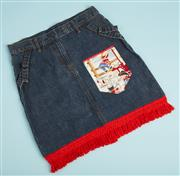 Sale 9071F - Lot 29 - A DENIM SKIRT WITH RED FRINGE; with back pocket depicting young cow boy and young cow, girl size 10
