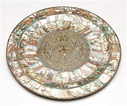 Sale 9238 - Lot 59 - A brass wall mountable plate, heavily inlaid with mother of pearl and featuring pressed Aztec design to centre (Dia:30cm)