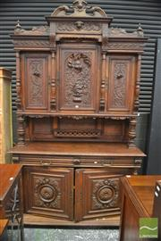 Sale 8317 - Lot 1074 - Early 20th Century French Carved Oak Credenza, with three carved panel doors, above an open shelf, with two drawers & two panel door...