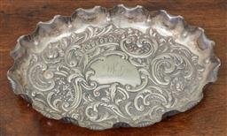 Sale 9120H - Lot 307 - A hallmarked sterling silver embossed tray in the rococo taste with monogrammed initials DLS to centre, Sheffield c. 1898, by Fenton...