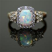 Sale 8196F - Lot 304 - A 10CT GOLD GEMSET RING: set with synthetic opal and cubic zirconias, size N.