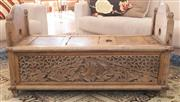 Sale 8380A - Lot 14 - A timber Balinese storage cradle with carved sides and ends, H 62 x W 110 x D 45cm