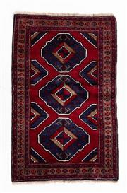 Sale 8800C - Lot 190 - A Persian Baluchi Tribal Hand Knotted Wool Rug, 87 x 134cm