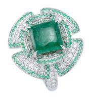 Sale 9054J - Lot 123 - AN 18CT WHITE GOLD EMERALD AND DIAMOND COCKTAIL RING; centring an 8 x 8mm cabochon emerald on a 2 tiered quatrefoil design border an...