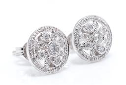 Sale 9246J - Lot 381 - A PAIR OF EDWARDIAN STYLE DIAMOND CLUSTER STUD EARRINGS; each centring a floral cluster of 9 millegrain set round brilliant cut diam...