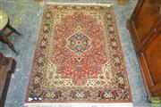 Sale 8255 - Lot 1068 - Small Persian Style Silk Carpet, the medallion on red field with floral arabesques (150 x 109cm)