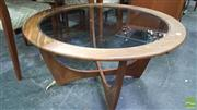 Sale 8383 - Lot 1014 - G-Plan Atmos Round Teak Coffee Table with Glass Top