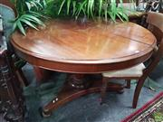 Sale 8601 - Lot 1032 - 19th Century Cedar Supper Table, the round top above a  faceted pedestal, on a triform base