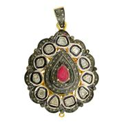 Sale 8060B - Lot 366 - A STERLING SILVER GILT GEM SET PENDANT; centring a pear shape ruby (treated) surrounded by a step and table cut diamonds.