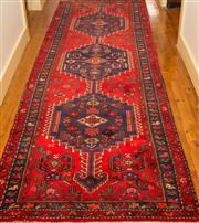 Sale 8270 - Lot 5 - A Persian Hamadan runner, with red ground and three medallions, 338 x 110cm