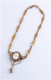 Sale 8550F - Lot 223 - An ornate 14ct gold cameo necklace.