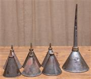 Sale 8984H - Lot 69 - A group of six early conical oil pourers including one large example. Tallest 27cm