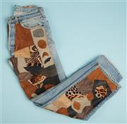 Sale 9071F - Lot 30 - A PAIR OF LEVI BESPOKE JEANS; in blue faded denim with leopard leather patchwork, size S