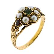 Sale 8173F - Lot 357 - A GEORGIAN 15CT GOLD STONE SET LOCKET RING; central cluster set with an emerald and pearls to 2 faceted rubies on scroll shoulders t...