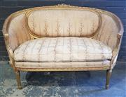 Sale 8976 - Lot 1019 - Louis XVI Style Carved Gilt Settee or Canape, of curved form, upholstered in a striped floral silk fabric (slight wear) & on turned...