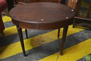 Sale 8291 - Lot 1071 - Georgian Style Mahogany Oval Occasional Table, with concealed drawer & carved tapering legs with blind fretwork