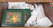 Sale 8489A - Lot 50 - A drawer full of ivory placemats, table mats and napkins, together with silver plated napkin rings