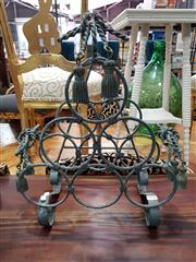 Sale 8904 - Lot 1030 - Scrolled Metal Wine Rack With Decorative Timber Tassels