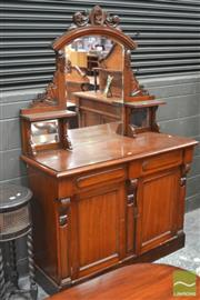Sale 8291 - Lot 1093 - Victorian Carved Walnut Chiffonier, with mirror back & shelves, above two drawers & two doors flanked by fascia (key in office)