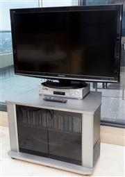 Sale 8593A - Lot 73 - A Panasonic 42'' flat screen TV on stand, together with a SONY video player, with TV unit and CD's, etc