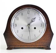 Sale 8960 - Lot 80 - An art deco oak cased mantle clock by Smiths England (H21cm), with key and pendulum