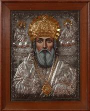Sale 9020H - Lot 89 - A St Nicolas pressed silver and gilt icon in a frame H53x44cm