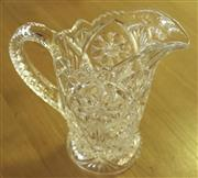 Sale 8319 - Lot 413 - 1920s Ornate clear glass jug with Australian floral motif