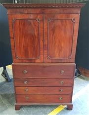 Sale 8956 - Lot 1003 - Late Georgian Mahogany Press on Secretaire Chest, the upper doors with corner rondels above a fitted secretaire drawer incl. secret...