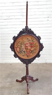 Sale 9068 - Lot 1011 - Victorian Rosewood Pole Screen, the carved oval frame with Berlin wool & stumpwork of colourful fruits and flowers, on an adjustable...