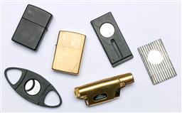 Sale 9144 - Lot 100 - A collection of lighters and Cigar cutters inc Zippo and Dupont