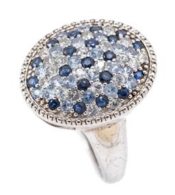 Sale 9169 - Lot 364 - A SILVER SAPPHIRE AND TOPAZ RING; domed oval top set with 22 round cut white topaz, 21 round cut light blue topaz and 20 round cut b...