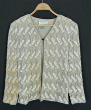 Sale 7982B - Lot 125 - A sequinned cocktail jacket by Papell Boutique in cream (M), some discolouration