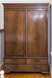 Sale 8270 - Lot 23 - An antique Mahogany Georgian Chippendale design wardrobe of superior quality. The dentil carved and blind fretwork cornice above a p...