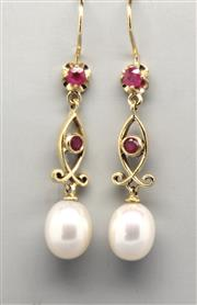 Sale 8265 - Lot 326 - A PAIR OF PEARL AND RUBY DROP EARRINGS; each a drop of 2 rubies suspending a cultured freshwater pearl in 9ct gold. Length 40mm.