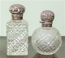Sale 9120H - Lot 316 - Two hallmarked silver topped cut glass perfume bottles, larger Height 13cm